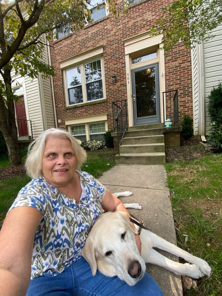 Photo of Cindy LaBon and her service dog, Gardenia.