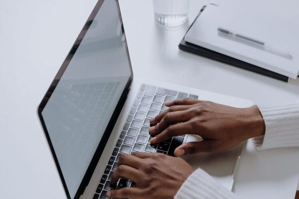 Photo of hands on a laptop keyboard