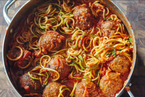 Zoodles and meatballs in a red sauce.