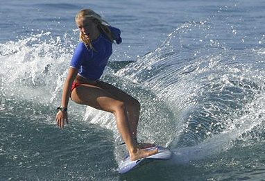 Promotional image for the film soul surfer featuring a young girl on a surf board in the ocean.