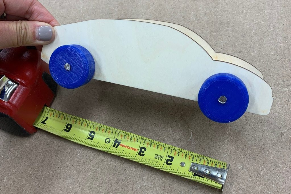 Photo of a wooden derby car measuring 5 inches.