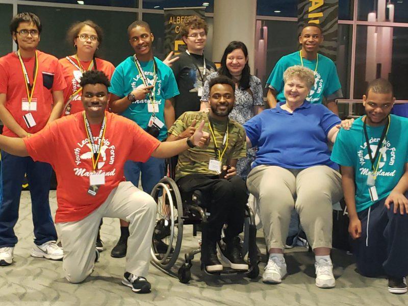 Photo of Nurse Betsy surrounded by maryland youth leadership forum delegates.
