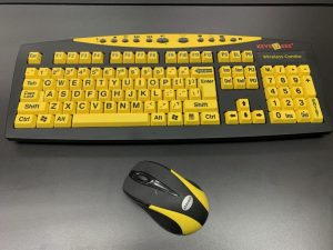 Photo of high contrast keyboard and mouse. The keyboard is black with bright yellow keys with large print black lettering.
