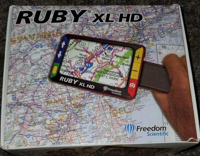 Photo of Ruby Handheld Magnifyer in box.