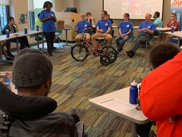 Photo of maryland youth leadership forum delegates with an adaptive bike
