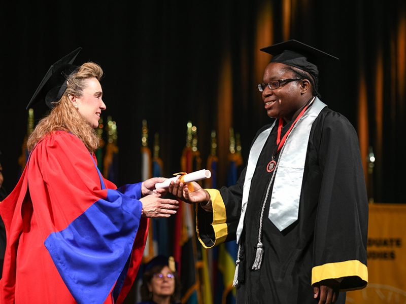 Photo of Montel in commencement robes receiving his college diploma.
