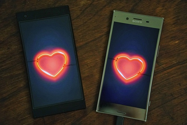 photo of cell phones with hearts on the screens.
