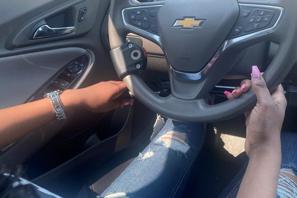 photo of steering wheel and hand controls of Danesha's modified vehicle.