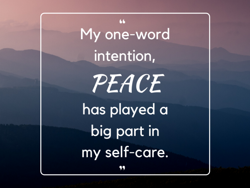 """Photo of purple misty mountains with text that says """"My one-word intention, 'PEACE' has played a big part in my self-care."""""""