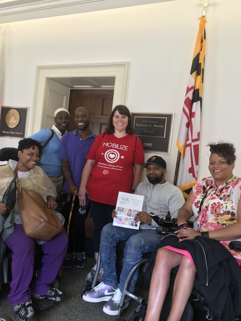 Photo of rochelle harrod, abiola heylinger, kelvin hawkins, sarah basehart, michael saunders, and shannon minnick outside the office of an elected official.