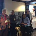 Photo of Denise Sosbe; Cindy LaBon and her guide dog, Gardenia; Shannon Minnick; and Sarah Basehart at a DORS conference.